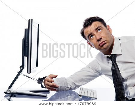 caucasian man chained to computer with handcuffs expressing addiction concept isolated studio on white background