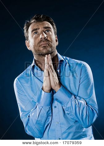 caucasian man unshaven praying wishful portrait isolated studio on black background