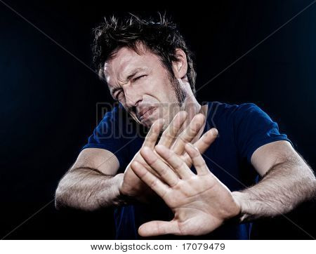 studio portrait on black background of a funny expressive caucasian man pucker stop rejection