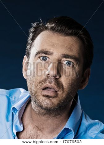 caucasian man unshaven stuned daze portrait isolated studio on black background