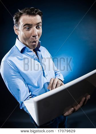 caucasian man internet surfing amazed portrait isolated studio on black background