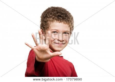 little caucasian boy portrait saluting isolated studio on white background