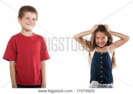 caucasian little boy smiling and girl pull hair portrait isolated studio on white background