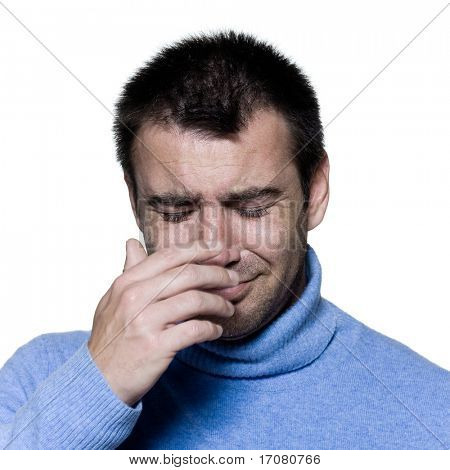 studio portrait on isolated background of a stubble man crying sad depression