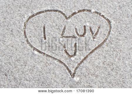 A love heart written in the snow