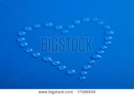 blue heart shape of water droplets