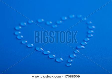 blue heart shape of water droplets