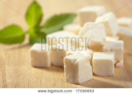 feta cheese on wooden cutting board