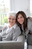 image of elderly woman  - Closeup of elderly woman with young woman - JPG