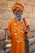 image of jain  - jain priest welcoming saluting in jaisalmer in rajasthan state in india - JPG