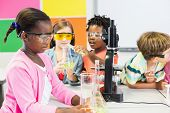Kids doing a chemical experiment in laboratory at school poster