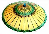 Ancient Asian Umbrella Open And Showing All The Green And Yellow Colors Of The Oriental Design poster