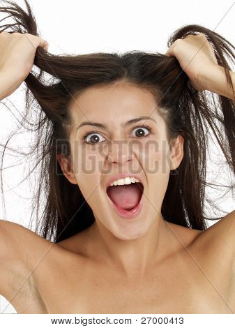 Young woman pulling her hair on white background.