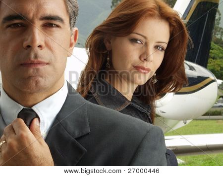 Business people before boarding a private jet.