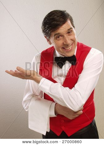 Gentile waiter portrait on white background.