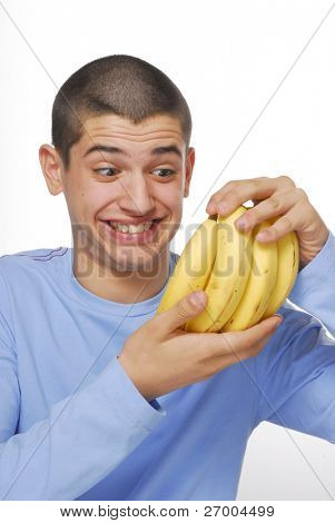 Yung boy holding a banana bunch on white background.