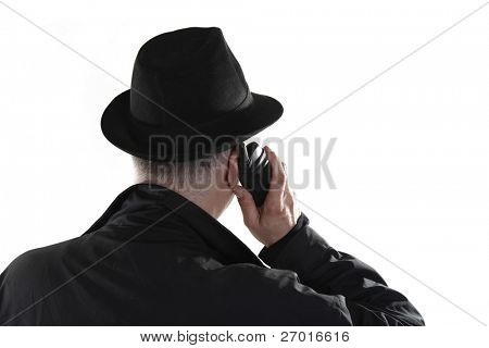 Man with hat is talking on phone from behind