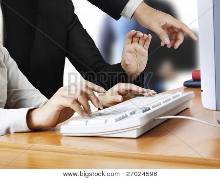 Hand touching computer keys during work