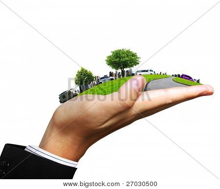 human hand holding a city