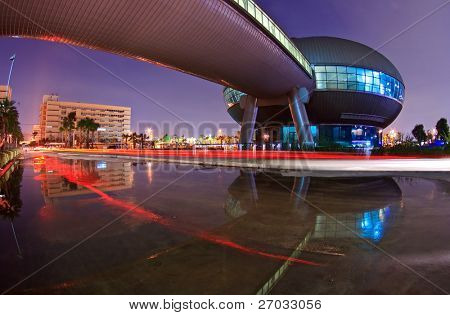BANGKOK, THAILAND-SEP 25:Light Trail and Government Complex Building dome shines at Dusk on Sep 25.2010 in Bangkok. Government Complex has 34 government units located at Chaeng Wattana St. in Bangkok.