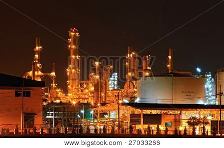 closeup of  petrochemical oil refinery plant and water storage tank