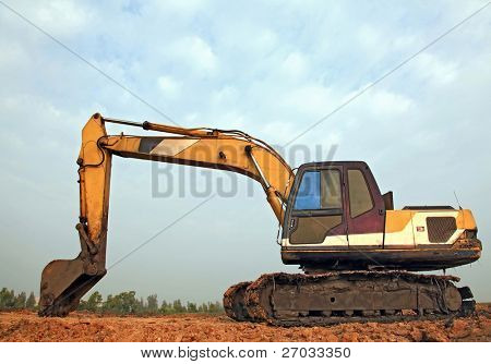 Excavator Loader with backhoe standing in sandpit