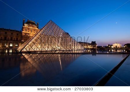PARIS - APRIL 16: Louvre at dusk during Summer Exhibition.  Louvre is the biggest Museum in Paris displayed over 60,000 square meters of exhibition space.