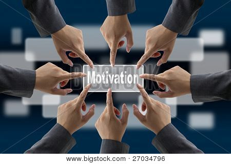 A diverse business team with hands together push motivation button