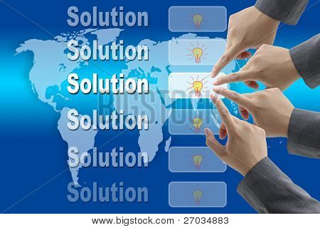 male business hand pushing on solution Innovation button with world map background