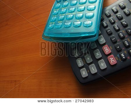 modern scientific calculator on the wooden table