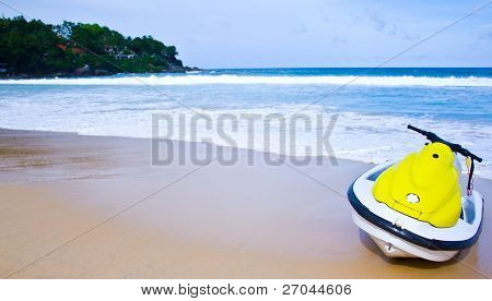 Yellow jet ski on the  beach - summertime