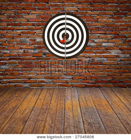 Dartboard on brick wall (Darts Hit Target)