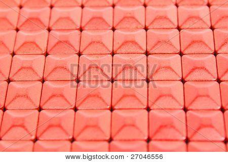 Red square medicinal pills