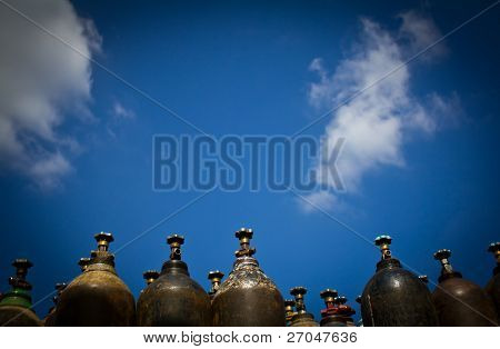 Old  oxygen tank and blue sky