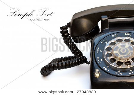 Close up of old-fashioned black telephone with copy space.