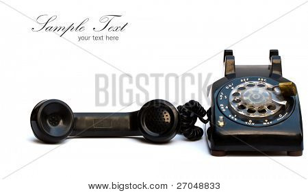 Old-fashioned black telephone on white background.