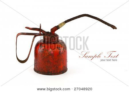 Antigue red rusty old oil can side view on white background