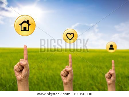 Hand pointing to house icon ,heart icon,people icon