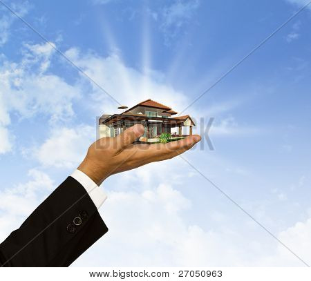 The house in Businessman hand