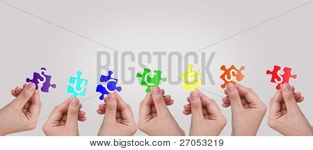 """Hands and puzzle with word """" Success """""""