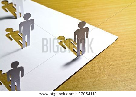 Social Network concept : close up of people cut out of paper on wooden table