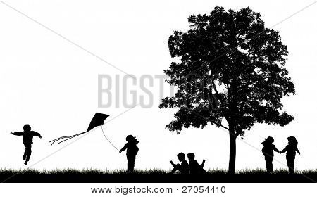 Silhouettes of children playing in grass with tree