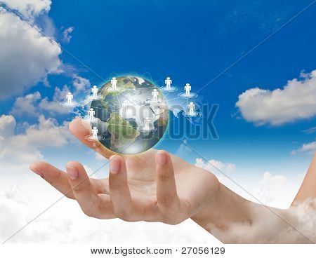 Social Network concept : hand hold earth of social network over blue sky