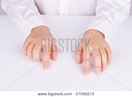 Two women's hands position like keying on keyboard on white table