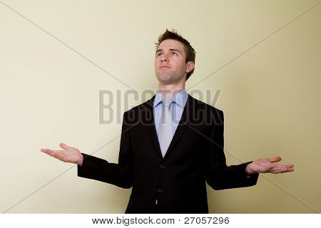 Portrait of young business man shrugging