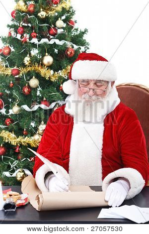 real Santa Claus writing list gifts on old paper scroll, isolated on white background