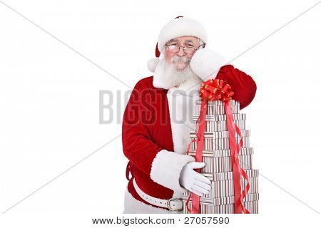 Santa Claus leaning on big stack of gift boxes, isolated on white background
