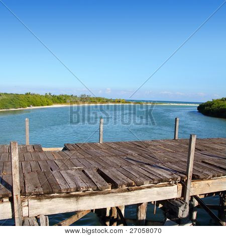 aged tropical wood bridge in Sian Kaan Tulum Mexico
