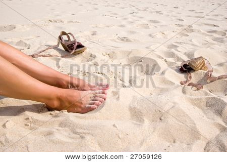woman legs and shoes on France atlantic beach
