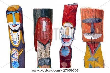 four colorful Thai moken totems isolated on white